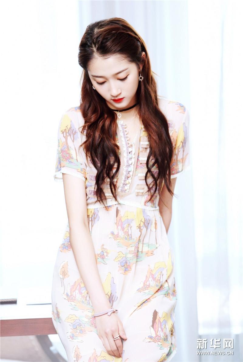 Красотка Гуань Сяотун