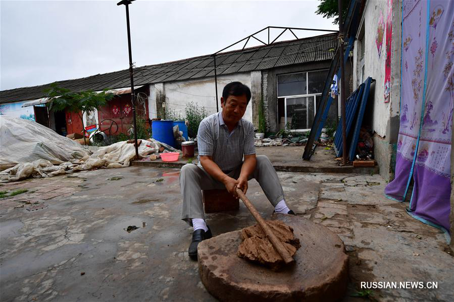 Глиняные собачки из уезда Хуайян провинции Хэнань