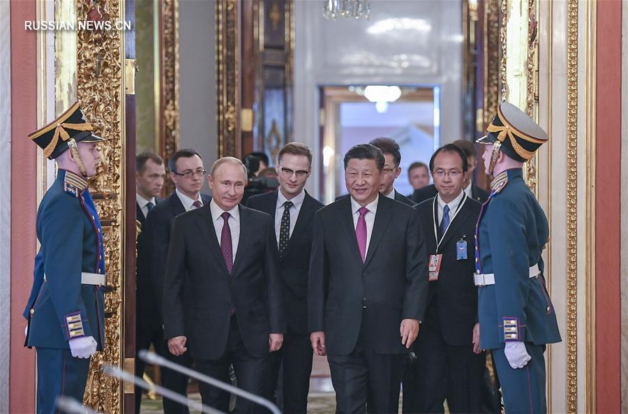 Си Цзиньпин и В. Путин провели переговоры и объявили о развитии китайско-российских всесторонних отношений стратегического взаимодействия и партнерства в новую эпоху