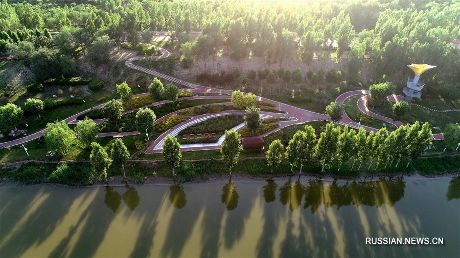 Пустынные берега реки в уезде Цзюйлу превратились в экопарк
