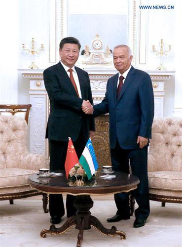 6月22日,国家主席习近平在塔什干库克萨莱国宾馆同乌兹别克斯坦总统卡里莫夫举行会谈。 [新华社]