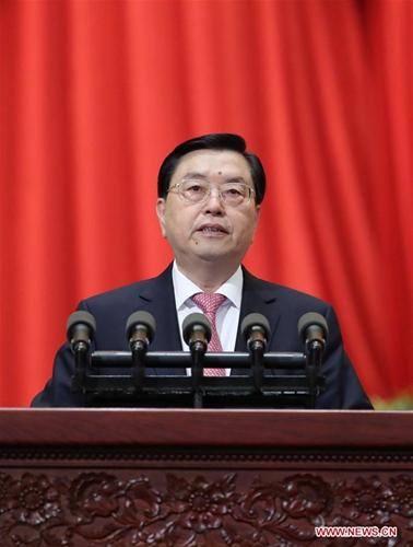 3月8日,全国人大常委会委员长张德江向十二届全国人大五次会议作《全国人民代表大会常务委员会工作报告》。 [新华社]