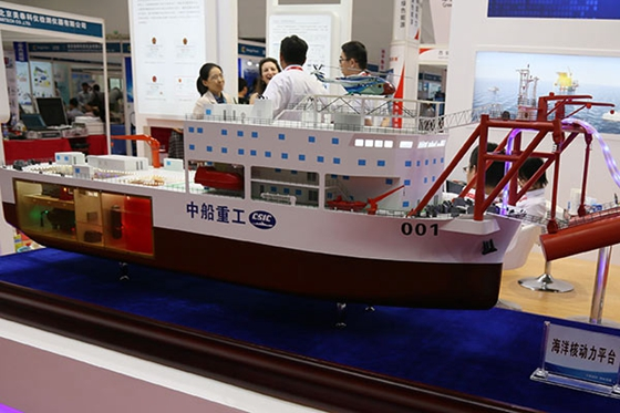 An offshore nuclear power station model on display at an industry expo in Beijing. [Photo/China Daily]