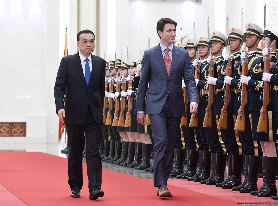 Chinese Premier Li Keqiang holds a welcome ceremony for Canadian Prime Minister Justin Trudeau before the second meeting of the Annual Dialogue between the Chinese premier and the Canadian prime minister in Beijing, capital of China, Dec. 4, 2017. [Photo/Xinhua]