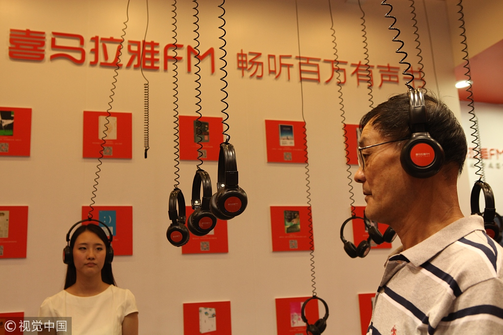 """Ximalaya FM held a """"show"""" of audio books during Shanghai Book Fair in June, 2015. [Photo credit: VCG]"""