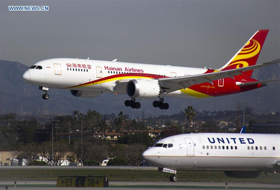 The first direct flight between Changsha and Los Angeles of China's Hainan Airlines arrives at the Los Angeles International Airport in Los Angeles, the United States, Jan. 21, 2016. [Photo/Xinhua]