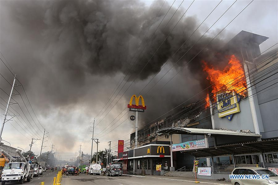 Fire hits Philippine mall; 1 dead, dozens missing