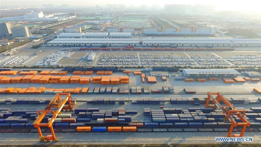 Containers are loaded to a freight train of China Railway Express at a railway container center in Zhengzhou, capital of central China's Henan Province, Dec. 25, 2017. [Photo/Xinhua]