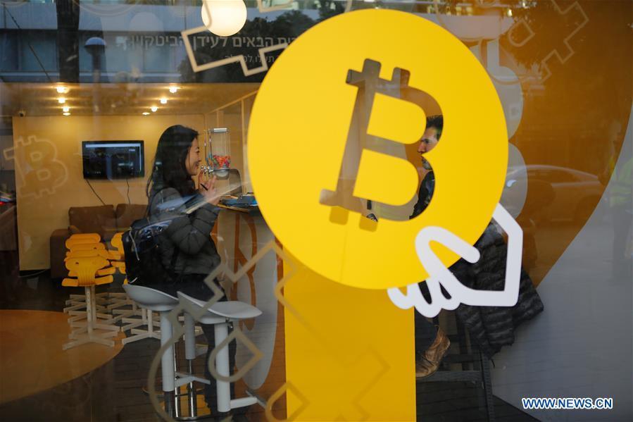 A woman buys Bitcoin at Bitcoin Change in Tel Aviv, Israel, on Jan. 8, 2018. [Photo/Xinhua]