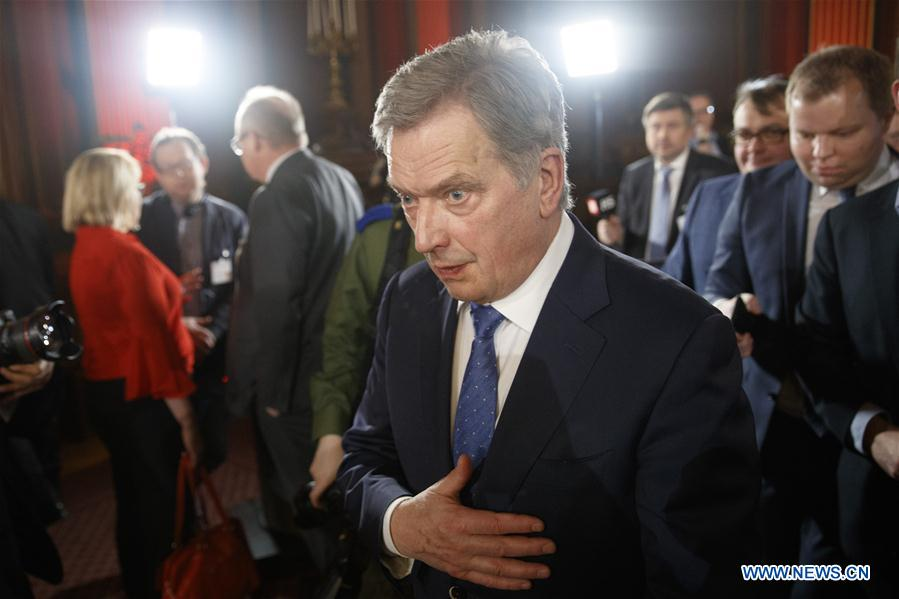 Finnish incumbent President Sauli Niinisto (front) attends a press conference after winning a landslide victory in the presidential election in Helsinki, Finland, on Jan. 28, 2018.