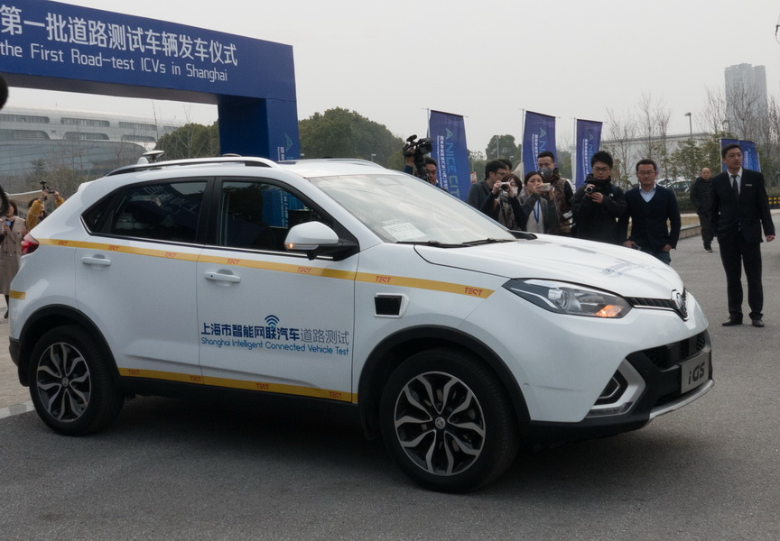 An intelligent connected vehicle takes part in road tests on Thursday in Shanghai. [Photo/China Daily]
