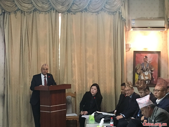 Binod Prasad Acharya, minister (economic) of the Embassy of Nepal in China, introduces prospects for investment in Nepal during the seminar on investment opportunities in hydropower projects in Nepal held in Beijing on March 23. [Photo by Cui Can/China.org.cn]
