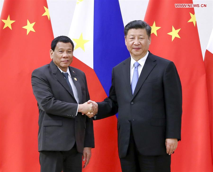 Chinese President Xi Jinping (R) meets with Philippine President Rodrigo Duterte in Boao, south China's Hainan Province, April 10, 2018. [Photo/Xinhua]