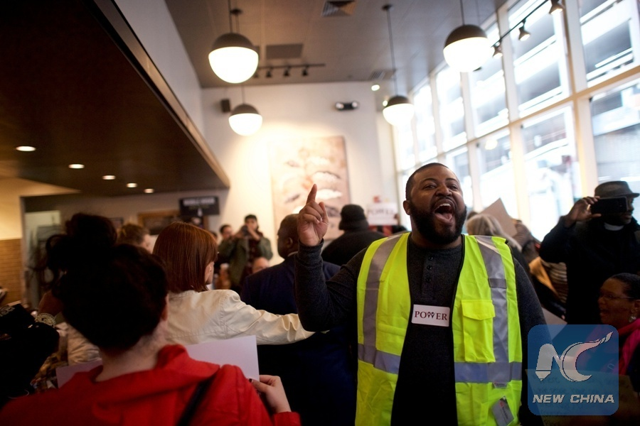 Interfaith clergy leaders stage a sit-in in a Center City Starbucks, near the location where two black men were arrested, in Philadelphia, Pennsylvania U.S. April 16, 2018. [Photo/Xinhua]