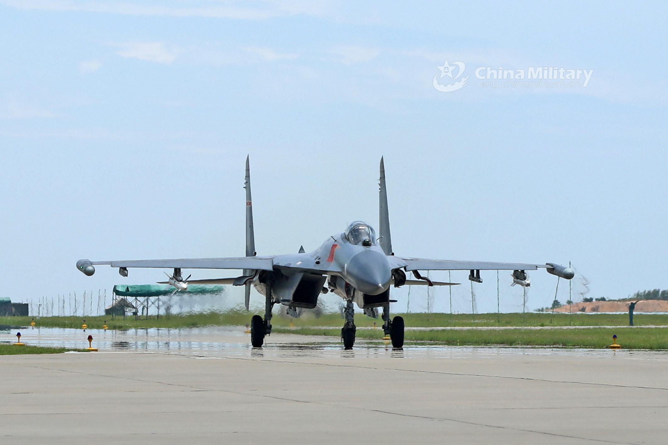 J-11 fighter jet in flight training- China org cn