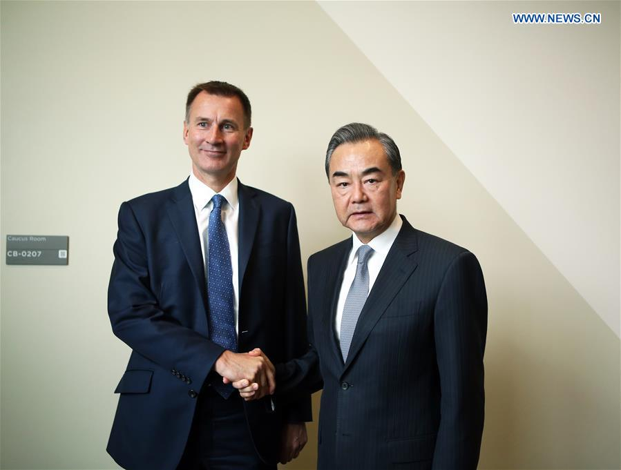 Chinese State Councilor and Foreign Minister Wang Yi (R) shakes hands with British Foreign Secretary Jeremy Hunt during their meeting at the United Nations headquarters in New York, on Sept. 24, 2018. [Photo/Xinhua]