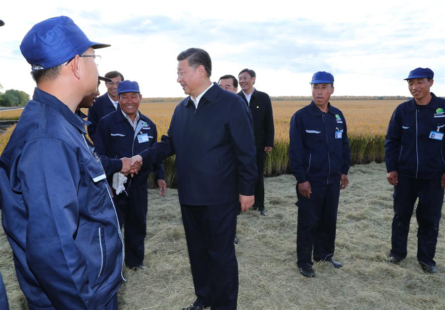 Chinese President Xi Jinping, also general secretary of the Communist Party of China (CPC) Central Committee and chairman of the Central Military Commission, talks with workers at Qixing farm, northeast China's Heilongjiang Province, Sept. 25, 2018. [Photo/Xinhua]