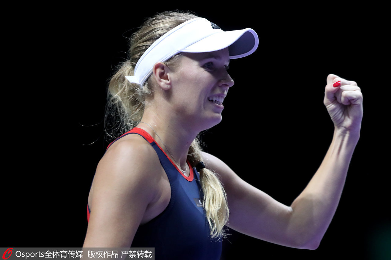 WTA Finals: Defending champion Caroline Wozniacki beats Petra Kvitova in Singapore