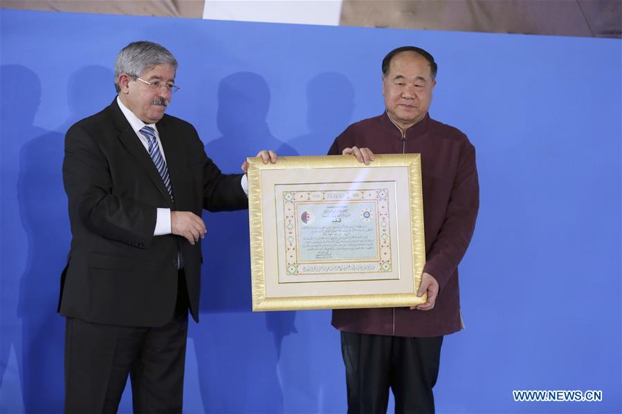 algerian prime minister ahmed ouyahia l awards the certificate of the national order of merit medal to chinese nobel laureate mo yan in algiers algeria