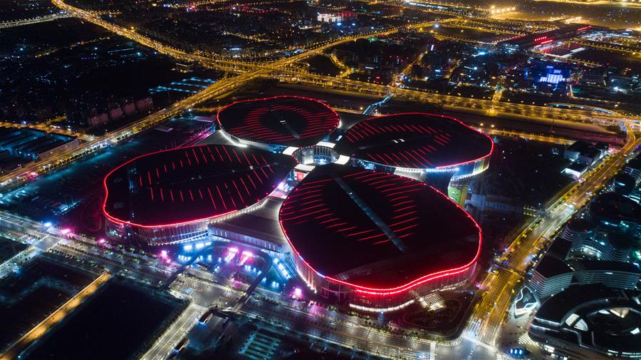 Aerial photo taken on Oct. 21, 2018 shows a night view of the National Exhibition and Convention Center (Shanghai), the main venue to hold the upcoming first China International Import Expo (CIIE), in Shanghai, east China. [Photo/Xinhua]