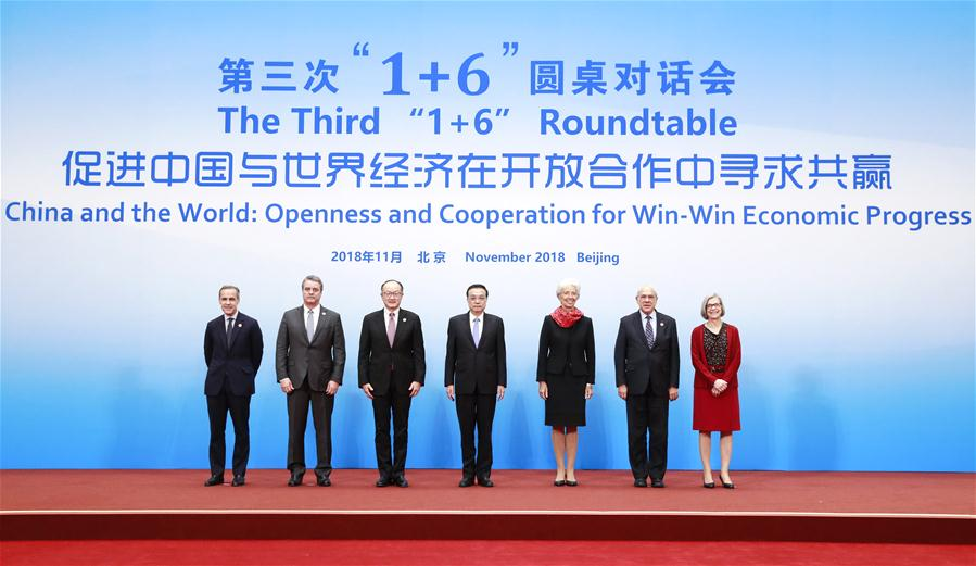 "Chinese Premier Li Keqiang (C), together with World Bank Group (WBG) President Jim Yong Kim (3rd L), International Monetary Fund (IMF) Managing Director Christine Lagarde (3rd R), World Trade Organization (WTO) Director-General Roberto Azevedo (2nd L), Organization for Economic Cooperation and Development (OECD) Secretary-General Angel Gurria (2nd R), Financial Stability Board (FSB) Chairman Mark Carney (1st L) and International Labor Organization (ILO) Deputy Director-General Deborah Greenfield (1st R), poses for a group photo before the third ""1+6"" Roundtable in Beijing, capital of China, on Nov. 6, 2018. (Xinhua"