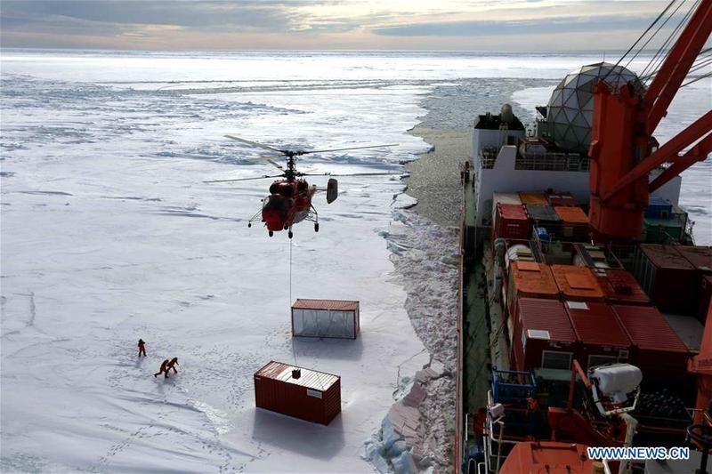 7c75723d7e6 Members of the research team use the helicopter to unload cargo at the  roadstead off the Zhongshan station in Antarctica, Dec. 1, 2018. China's  research ...