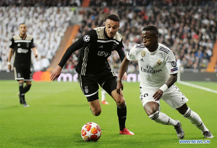c72c4920c Real Madrid s Vinicius Junior (R) vies with Ajax s Noussair Mazraoui during  the UEFA Champions League round of 16 second leg soccer match between Real  ...