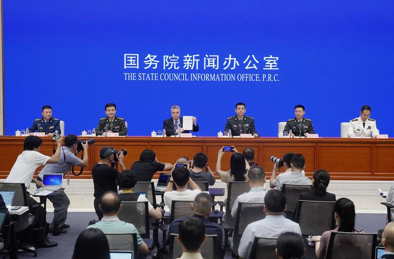 China says it will never seek hegemony in national defense