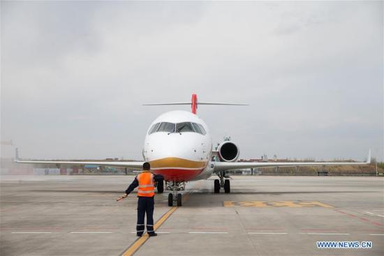 ARJ21 regional passenger jetliner showcases high-altitude performance