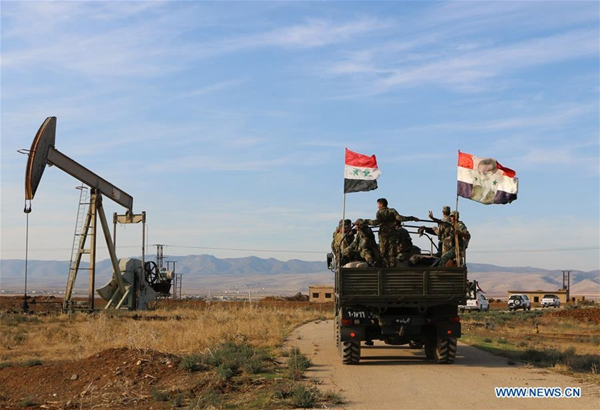 Syrian army reaches oil fields in Kurdish-held areas