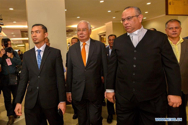 Former Malaysian PM faces trial over tampering with 1MDB report