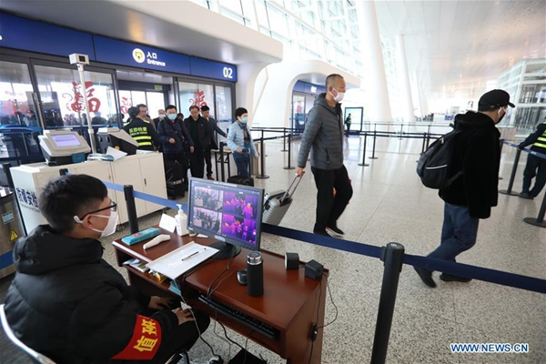 Wuhan suspends public transportation, outward flights, trains