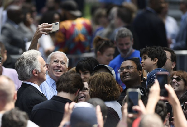 Former U.S. Vice President Joe Biden takes selfie with supporters during a rally in Philadelphia