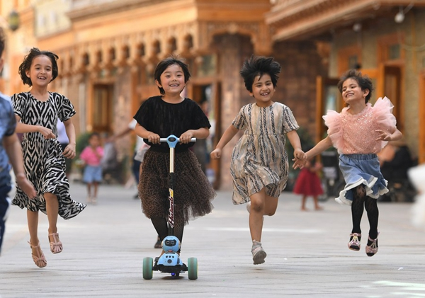 Children have fun on Dove Lane in Hotan City northwest China's Xinjiang Uygur Autonomous Region