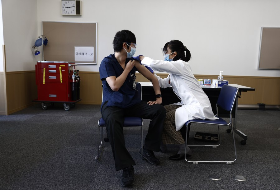 Japan begins accepting 'vaccine passports' applications